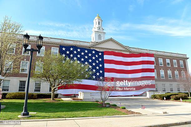CONTENT] City Hall in Medford Massachusetts is draped in a 45 x 90 ft American Flag on Monday April 22 2013 to honor those impacted by the Boston...