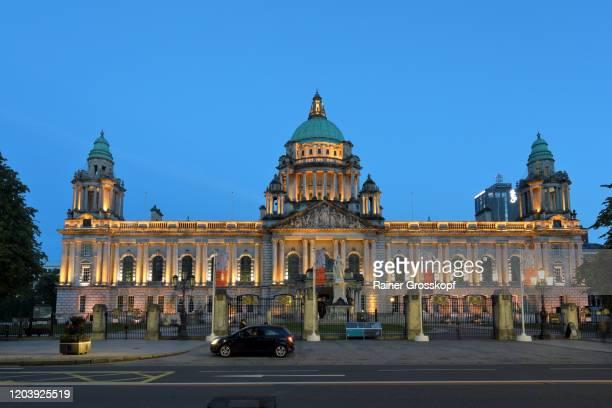 city hall of belfast illuminated at dusk - rainer grosskopf ストックフォトと画像