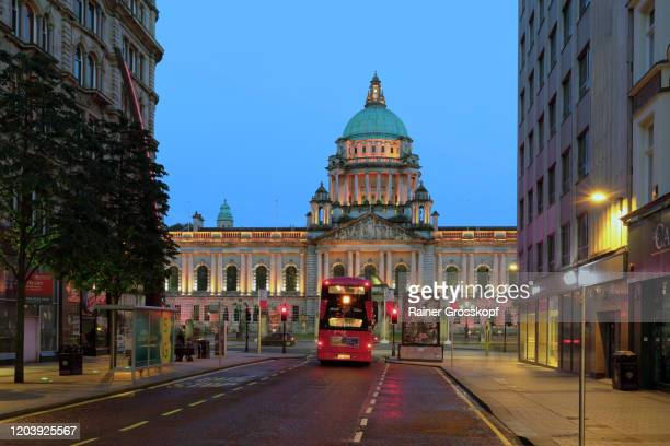 city hall of belfast illuminated at dusk - rainer grosskopf stock pictures, royalty-free photos & images