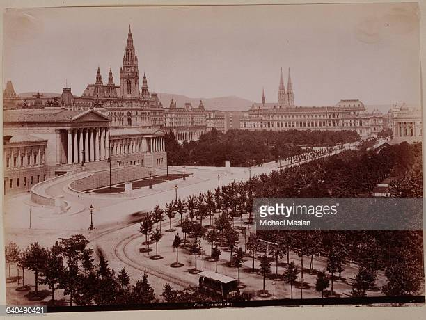 City Hall Parliament Building and other government buildings in Vienna Austria ca 1890 Tracks for a horsedrawn trolley pass in front of the buildings...