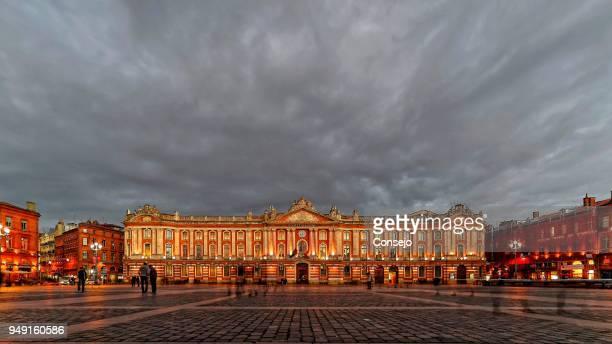 city hall with a cloudy sky, toulouse, haute-garonne, france - toulouse photos et images de collection