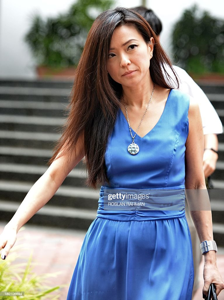 City Harvest Church's former finance manager Serina Wee leaves on a lunch break during her trial at the subordinate courts in Singapore on September 9, 2013. The trial continues for the leaders of a Singapore-based Christian church accused of embezzling millions of dollars to finance the singing career of the pastor's wife.