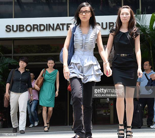 City Harvest Church's former finance managers Serina Wee and Sharon Tan leave on a lunch break during her trial at the subordinate courts in...