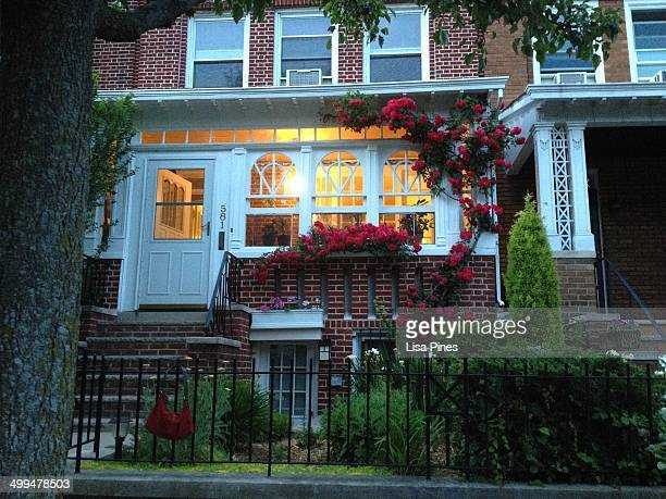 A city home in Windsor Terrace Brooklyn NY with a beautiful front garden full of roses released