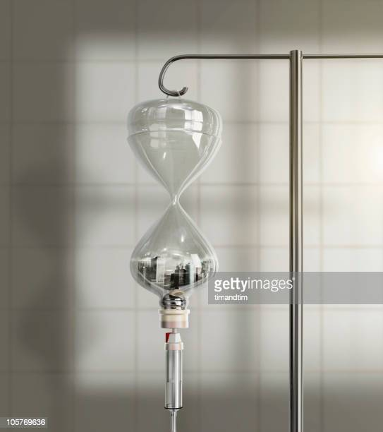 city in saline solution hourglass bottle  - iv drip stock pictures, royalty-free photos & images