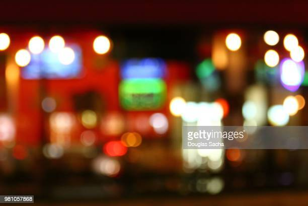 city life at night - soft focus stock pictures, royalty-free photos & images