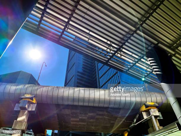 city life, corporate buildings, highway overpass with sun and lens flare - darling harbour stock pictures, royalty-free photos & images