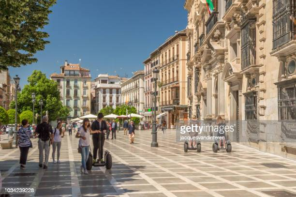 city life in granada, spain - granada spain landmark stock pictures, royalty-free photos & images