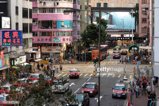 city life in the streets of wan chai, hong kong - wanchai stock photos and pictures