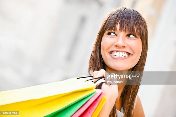 City life series: happy young woman holding shopping bags