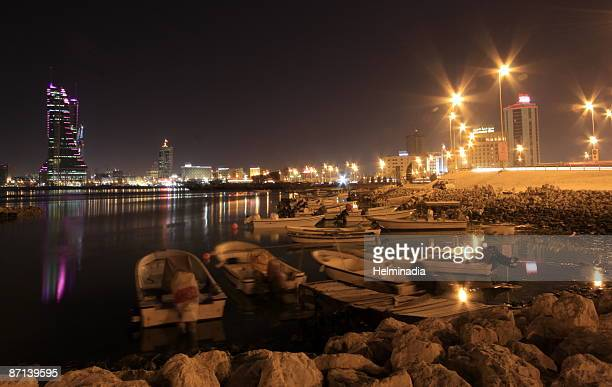 city lights around the bay - manama stock pictures, royalty-free photos & images