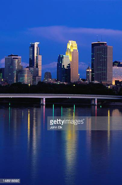 City lights at sunset, reflected on the waters of the Mississippi - Minneapolis-St Paul, Minnesota