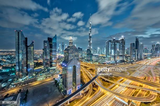 city lights in dubai at dawn - financial district stock pictures, royalty-free photos & images
