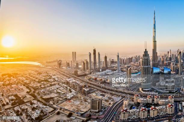 city lights in dubai at sunrise - middle east stock pictures, royalty-free photos & images