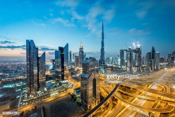 city lights in dubai; united arab emirates - skyline stock pictures, royalty-free photos & images