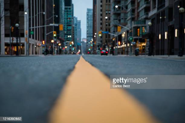city lights low view perspective - empty city coronavirus stock pictures, royalty-free photos & images