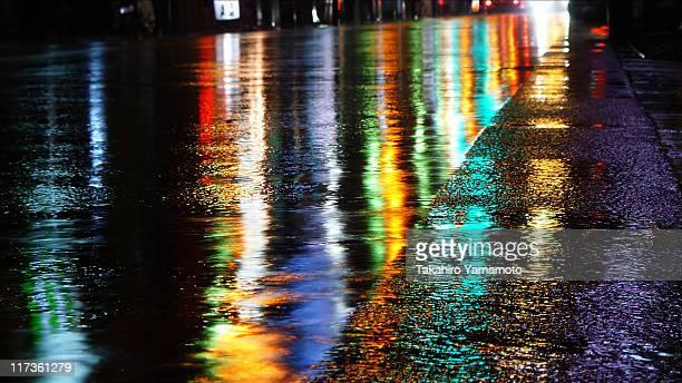 City lights on wet asphalt