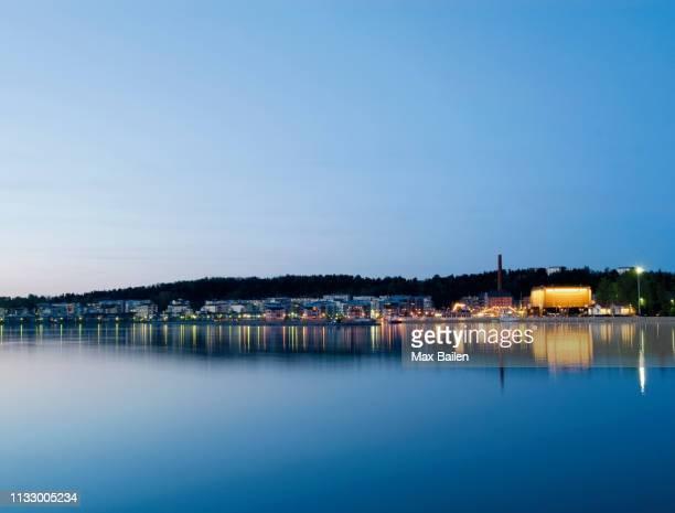 city lights reflected in still water - lahti finland bildbanksfoton och bilder