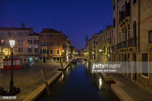 City lights reflected in urban canal