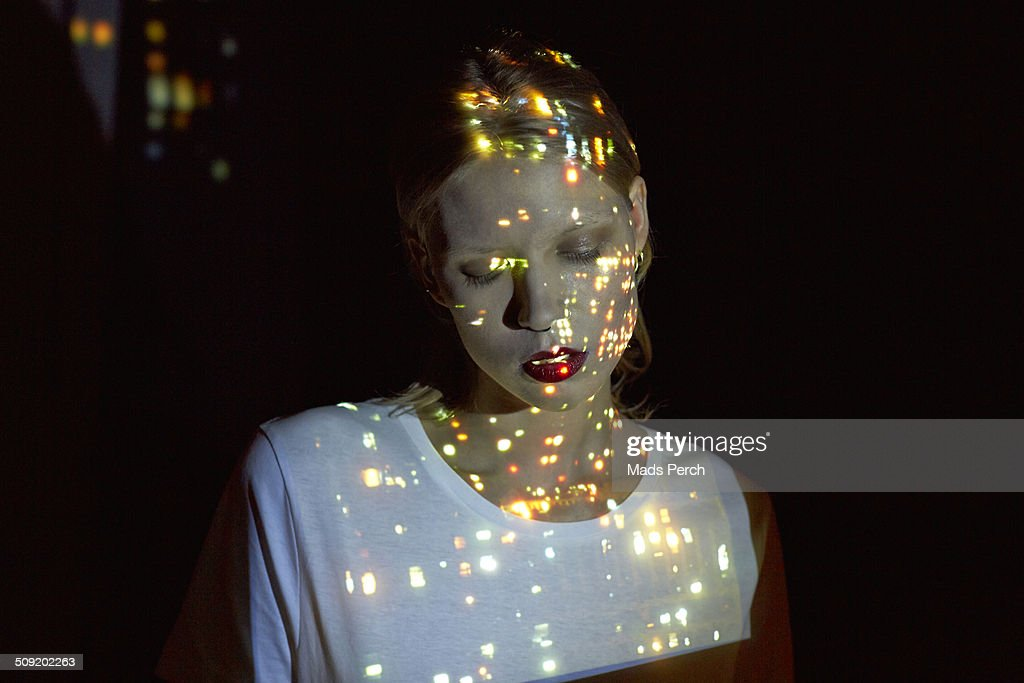 City Lights Reflected on to Young Woman : Stock Photo