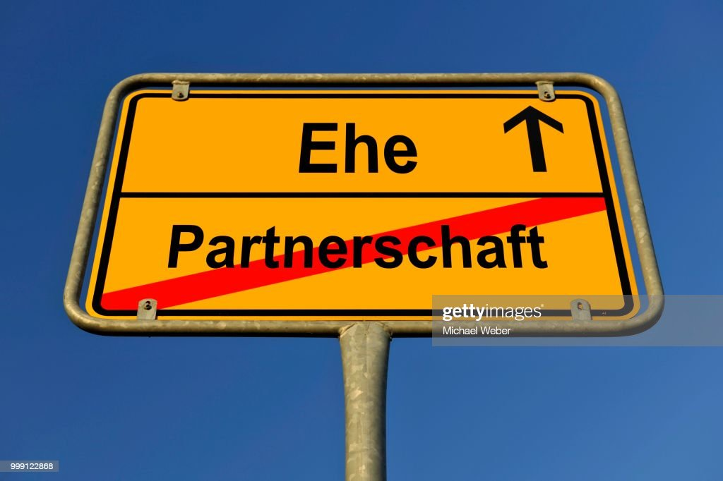 city limit sign symbolic image in german for contradiction between