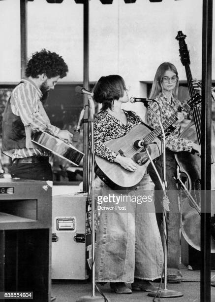 City Limits Bluegrass Band from left Patrick Rossiter dobro and sixstring guitar Lynn Morris sixstring guitar and Mary Stribling bass fiddle...