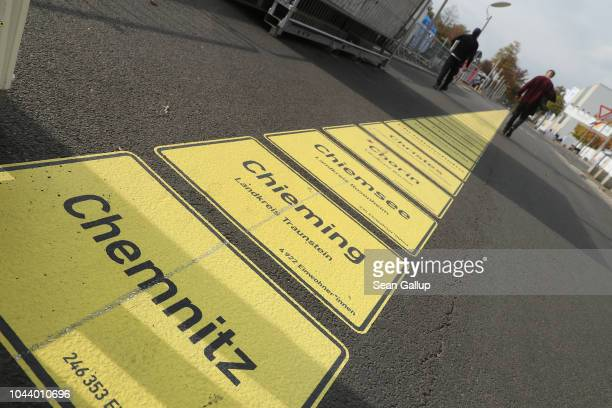 City limits signs including Chemnitz form a walkway in the city center as part of celebrations to mark German Unity Day scheduled for Wednesday on...