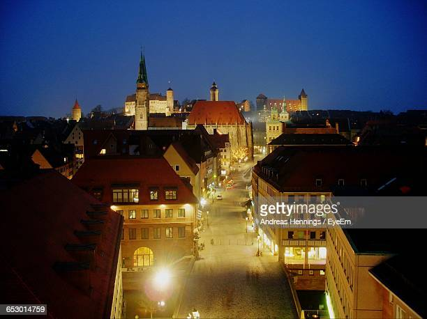 city lit up at night - nuremberg stock pictures, royalty-free photos & images