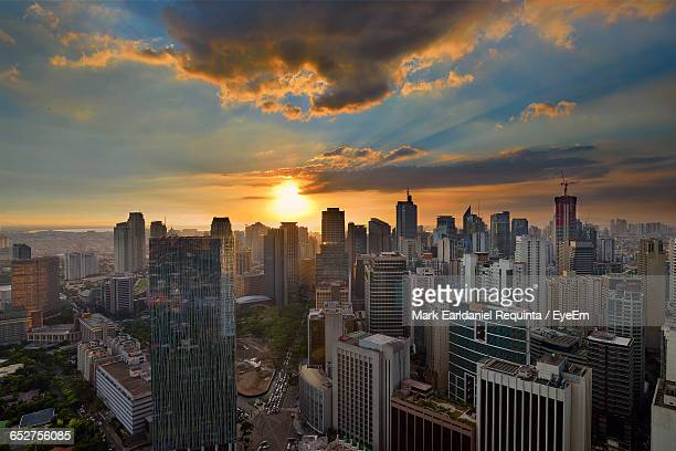 city lit up at sunset - makati stock photos and pictures
