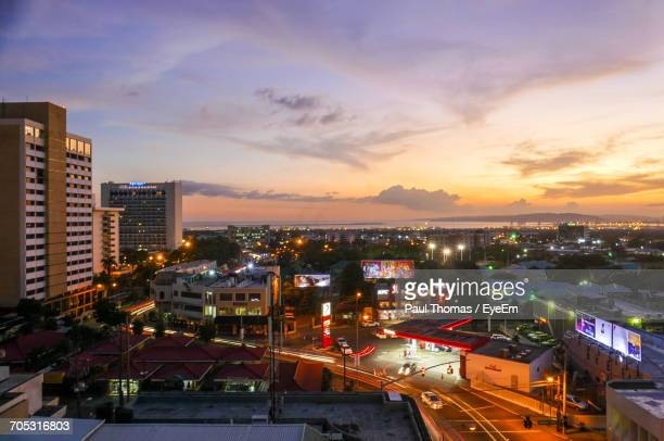 city lit up at sunset - kingston jamaica stock pictures, royalty-free photos & images