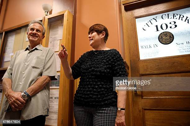 City Manager Richard Rossi left and City Clerk Donna Lopez talks about the historic gay marriages that took place in Cambridge in May 2004 during an...