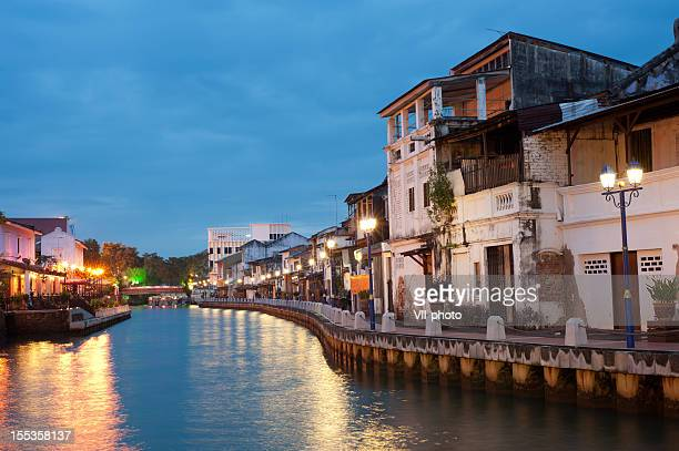 city next to the river with many lights - malaysia stock pictures, royalty-free photos & images