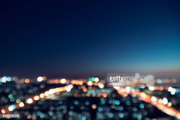 city night bokeh - licht stock-fotos und bilder
