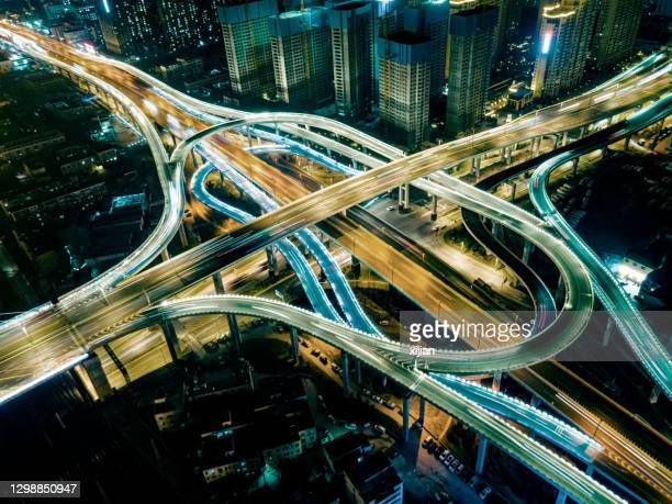 city night overpass - turning stock pictures, royalty-free photos & images