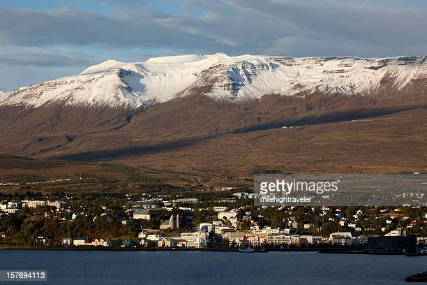 City of Akureyri Iceland with snow covered mountains