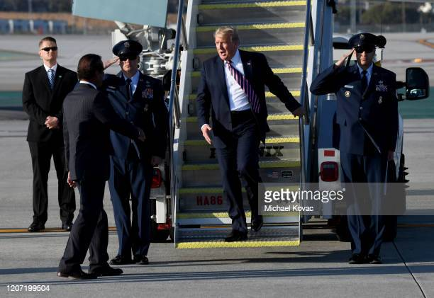 City of Anaheim Mayor Harry Sidhu welcomes US President Donald Trump after the President arrived on Air Force One at LAX Airport on February 18 2020...