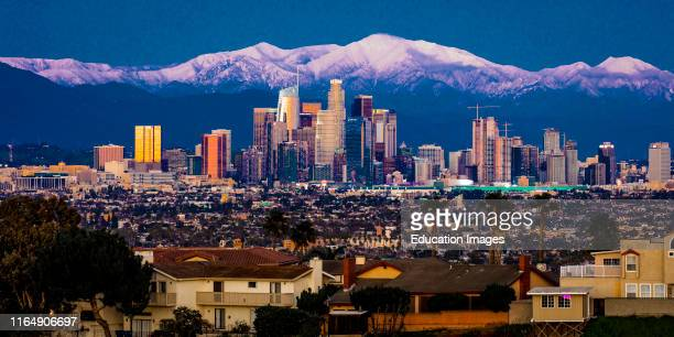 City of Angeles Los Angeles Skyline framed by San Bernadino Mountains and Mount Baldy with fresh snow from Kenneth Hahn State Park