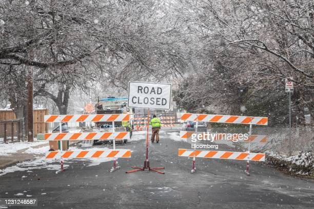 City of Austin worker surveys a recently mended water pipe after it froze in Austin, Texas, U.S., on Thursday, Feb. 18, 2021. Texas is restricting...