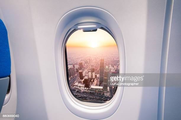 city of beijing from airplane - porthole stock photos and pictures