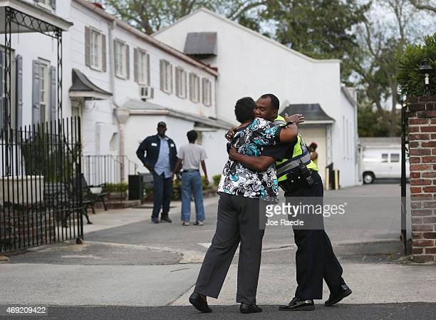 City of Charleston Police Captain Dale Middleton hugs Christine Bannister outside of the Fielding Funeral Home where the wake for Walter Scott was...