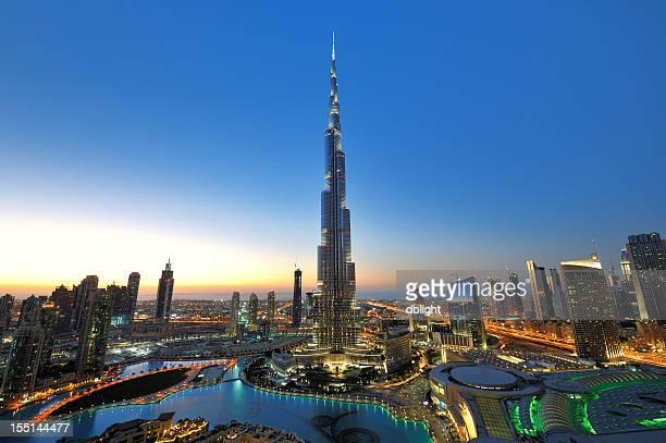 city of dubai at sunset - burj khalifa stock photos and pictures