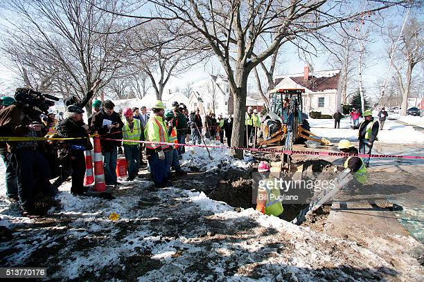 City of Flint Michigan workers prepare to replace a lead water service line pipe at the site of the first Flint home with high lead levels to have...