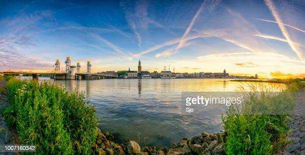 city of kampen in the netherlands during a colorful sunset - overijssel stock pictures, royalty-free photos & images