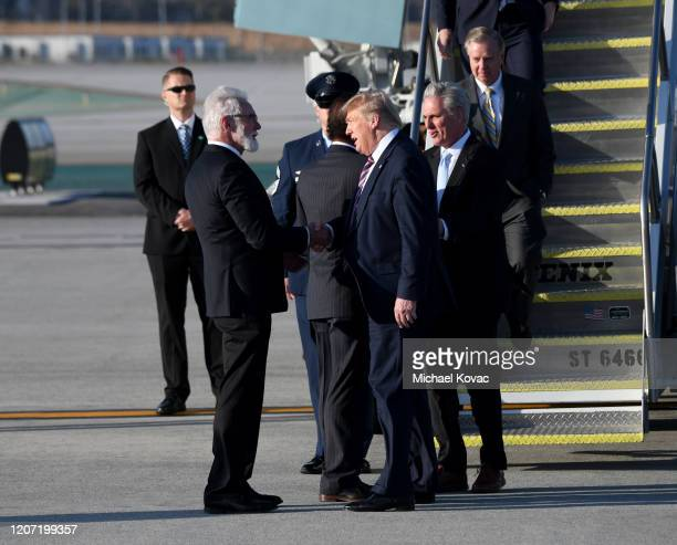 City of Lancaster Mayor R Rex Parris welcomes US President Donald Trump after the President arrived on Air Force One at LAX Airport on February 18...