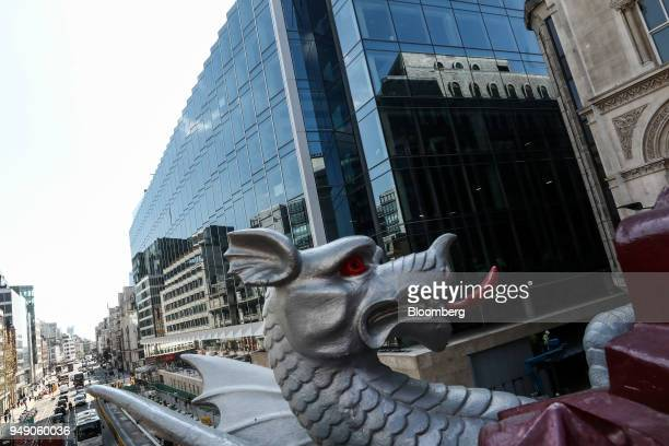A 'City of London Dragon' statue stands in view of the new European headquarters of Goldman Sachs Group Inc in London in London UK on Friday April 20...
