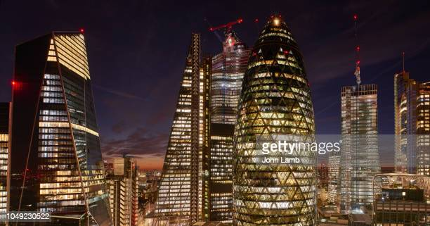 city of london financial district at dusk - business finance and industry stock pictures, royalty-free photos & images