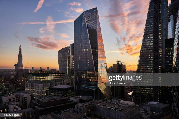 city of london financial district at sunset - londra foto e immagini stock