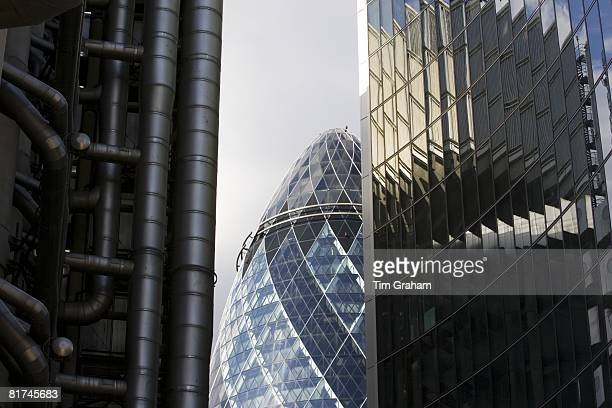 City of London landmarks Swiss Re Building seen between The Lloyds Building and The Willis Building England UK