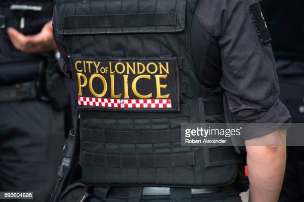 City of London Police Department officer stands at the entrance to an underground station in London England