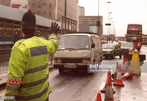 City of London police officer stops a van crossing the London Bridge on its way into the financial district as security was stepped up 10 February...